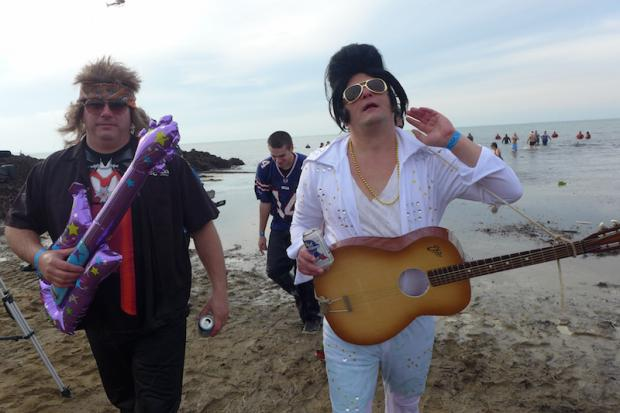 Chris Kinsley (Elvis), and Dave Deck (Canadian Rocker) emerging from the waters off of Woodlawn State Park Beach. Photo by Nancy J. Parisi.