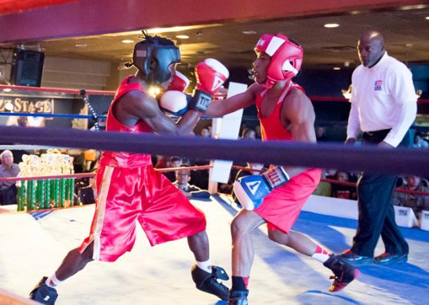 Jeffery Ngyayot (left) against Sequan Felton, by Errol Daniels.