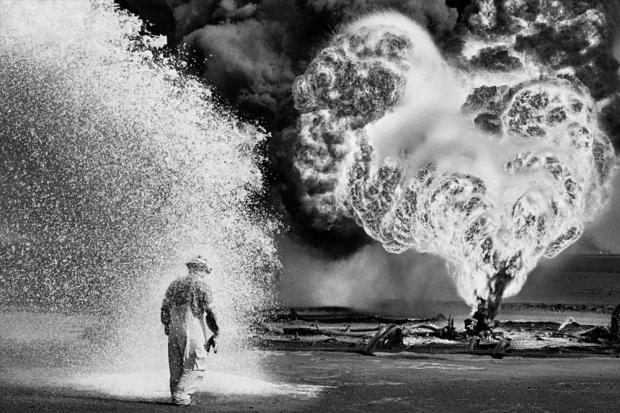 A photo by Sebastião Salgado in Kuwait's Greater Burgan Oil Field, 1991.