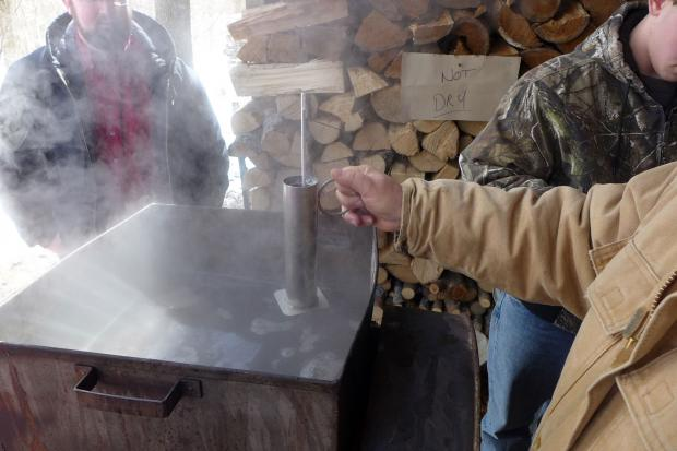 Fred Thurnherr testing sugar content of boiling sap. Photo by Nancy J. Parisi.
