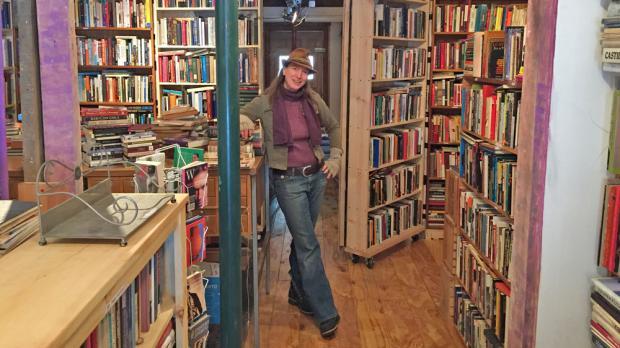 Rust Belt Books steward Kristi Meal in the new 415 Grant Street shop.