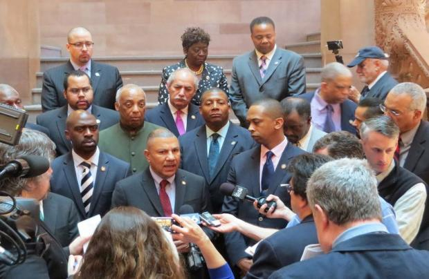 Assemblyman Philip Ramos and fellow members of the Black, Puerto Rican, Hispanic and Asian Legislative Caucus call for criminal justice reforms on the Million Dollar Staircase at the state Capitol on Wednesday. (Ashley Hupfl)