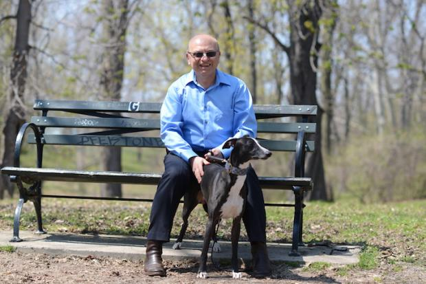 Vladislav Sandler at Delaware Park with his dog. Photo by Nancy J. Parisi.