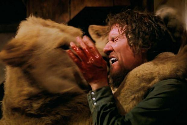 """Hank (Noel Marshall) receives a """"kiss"""" from one of the lions in Drafthouse Films' / Olive Films' release of Roar. Courtesy of Drafthouse Films / Olive Films."""