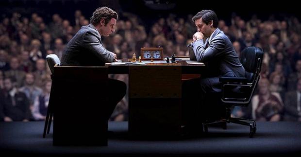 Liev Schreiber as Boris Spassky and Tobey Maguire as Bobby Fisher in Pawn Sacrifice.