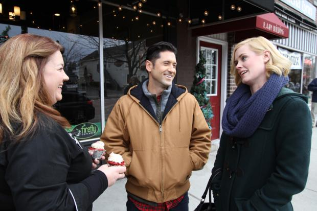 Firefly Cupcakes owner Wendy Egloff has a cameo with David O'Donnell and Abigail Hawk on Main Street in East Aurora. Photos courtesy of the Buffalo Niagara Film Office.