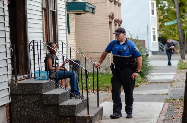 Albany Police Officer Justin Wallace talks with an Albany resident as part of his duty on the city's neighborhood engagement unit. (Heather Ainsworth)
