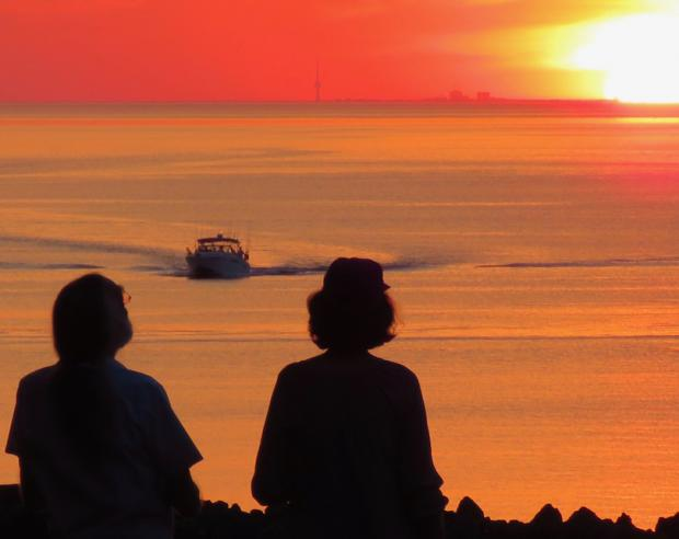 Is the sun setting on Lake Ontario? Shot from Olcott, Toronto on the horizon. Photo by Jay Jurney