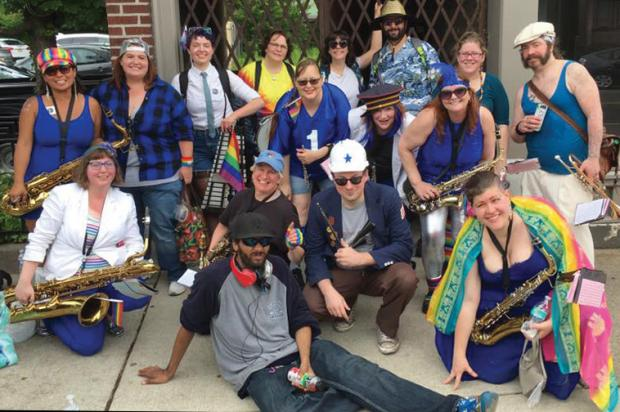 "Brass Pro & the Waterfront Revivalists, led by baritone saxophonist Kim Saben (front row, left) is a 10-15-member ""party band with a marching problem."""
