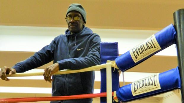 Coach Darryl Graham stands ringside during a training session at the PAL's Hennepin Youth Center.