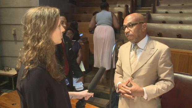 Investigative Post's Daniela Porat questioning Buffalo Common Council President Darius Pridgen after the September 26 meeting of the Council's Police Oversight Committee. Photo courtesy WGRZ-TV.