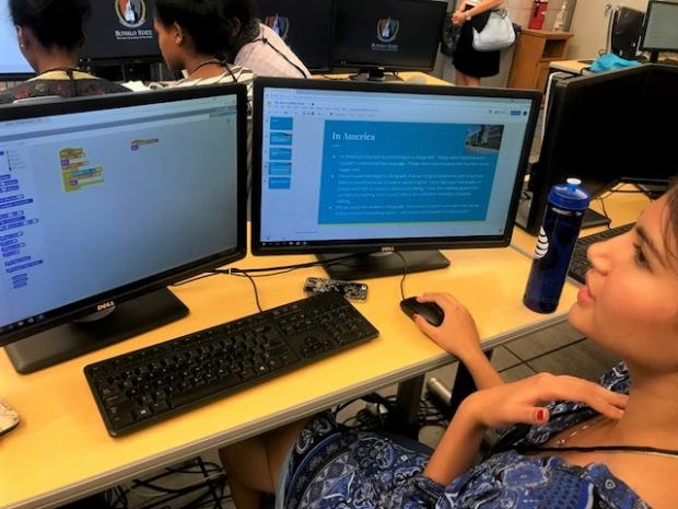 Bina Dahal, originally of Nepal, explains the game she's coded during her time in the program. Photo by Cathleen Draper.