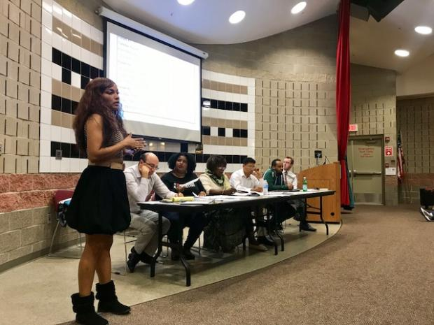 Yasmin Young, a member of the Buffalo Police Advisory Committee, addresses a community meeting Tuesday night at the Frank E. Merriweather, Jr. Library. Photo by Cathleen Draper.