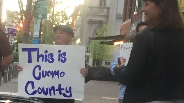 "Is this Cuomo ""County""? Maybe so, but the protestors at a Cynthia Nixon event last Friday—or at least the signs they held—seemed to have come from out of town. Also, who is the man in the cap?"