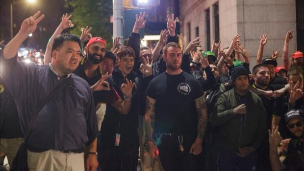 Proud Boys posing Friday outside New York City's Metropolitan Republican Club. (Photo credit: Twitter @HuntedHorse.)