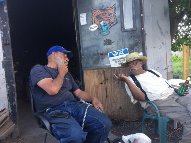 """""""Swannie"""" Jim Watkins and Kenn """"Pops"""" Morgan discuss the fine points of grilling. Photo by J. Tim Raymond."""