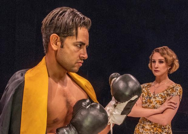 Anthony Alcocer as young boxer Joe Bonaparte and Cassie Cameron as love interest Lorna Moon in Golden Boy. Photo by Gene Witkowski.