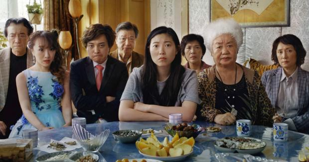 Awkwafina (center) heads the cast of The Farewell.